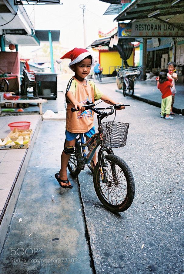 Cute kid at Crab Island (Pulau Ketam), Selangor, Malaysia.