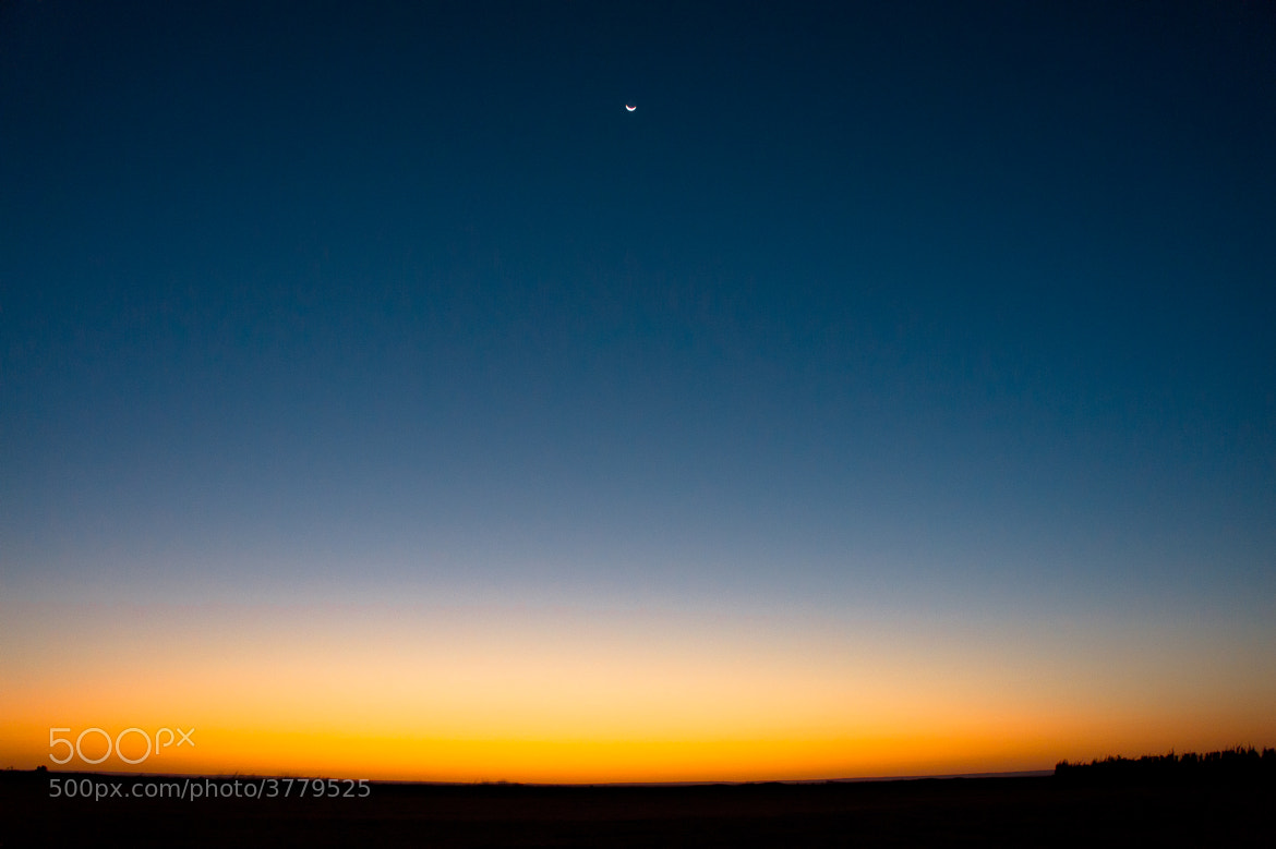 Photograph Crescent Moon above the sunrise by Human Adams on 500px