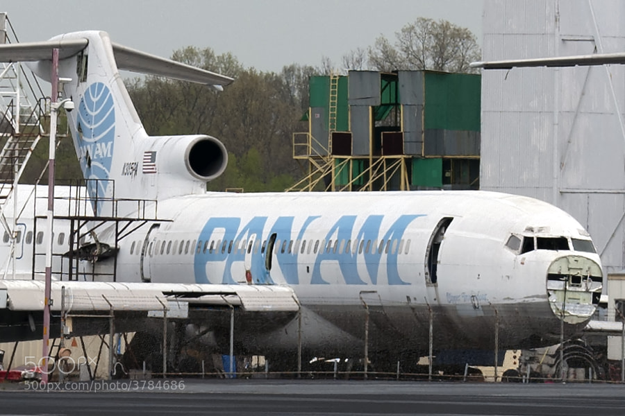 An old Pan Am 727 Clippership sits in a plane boneyard