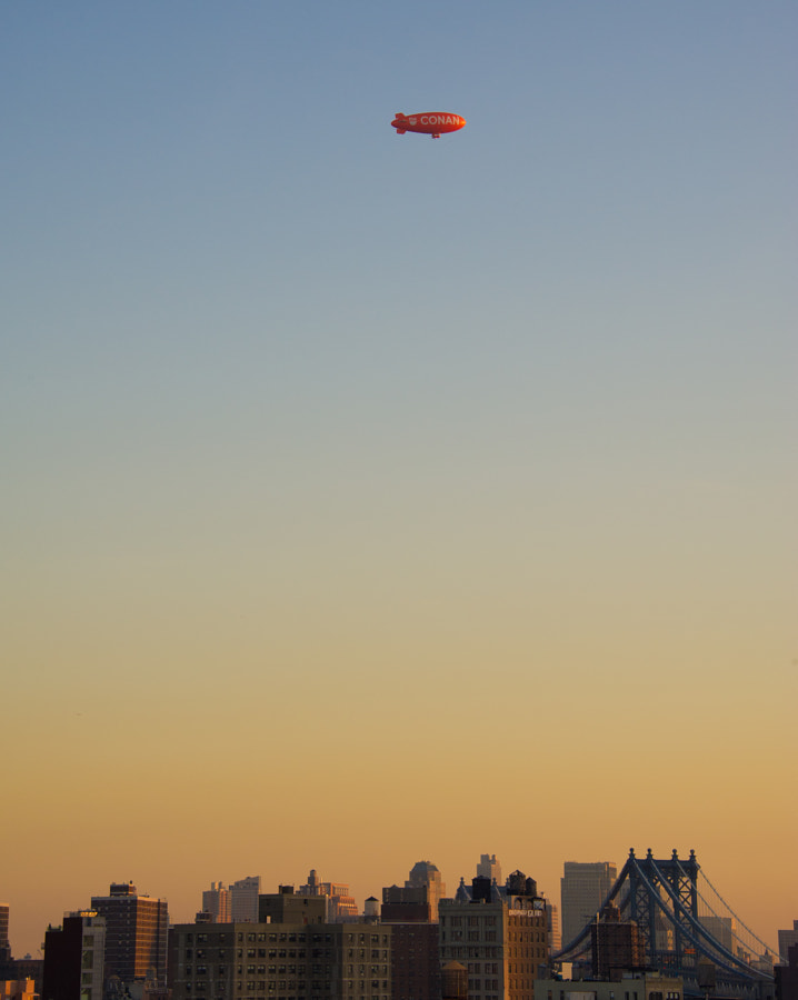 Airship over NYC at sunset