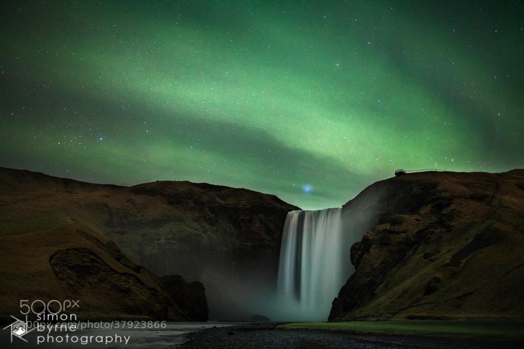 Photograph Aurora Borealis, Skogafoss, Iceland by Simon Byrne on 500px