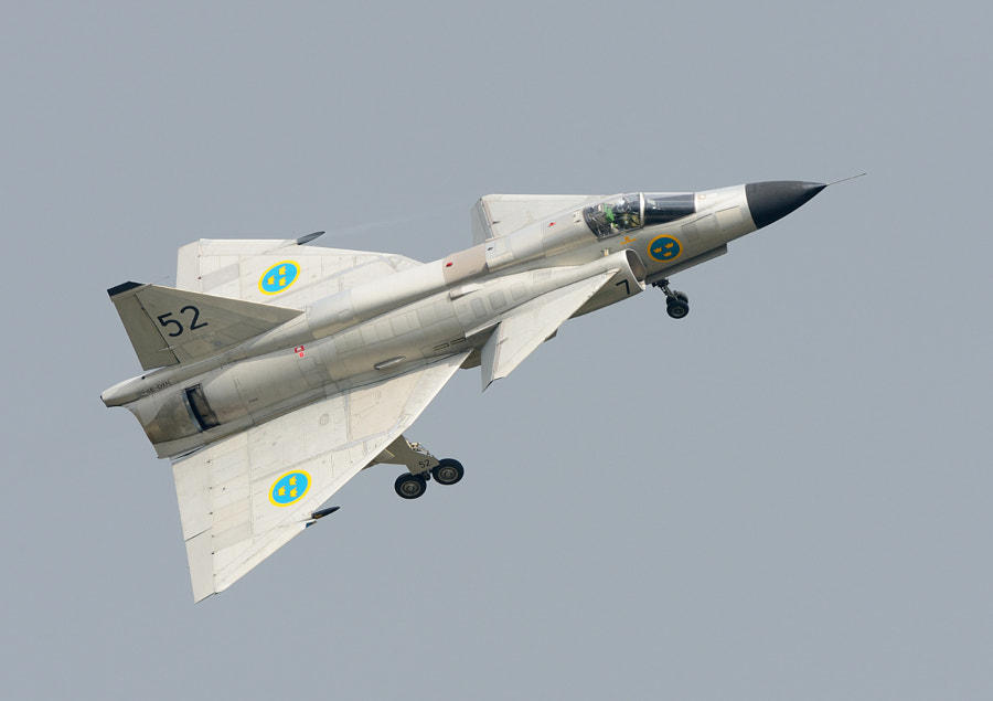 This Saab AJS-37 Viggen (Thunderbolt) of the Swedish Air Force, with the fantastic pilot Stellan Andersson holding the Joystick, is the last one of its kind which still does fantastic flight displays.  Shot taken at Volkel Air Base in the Netherlands.  Best wishes,  Harry