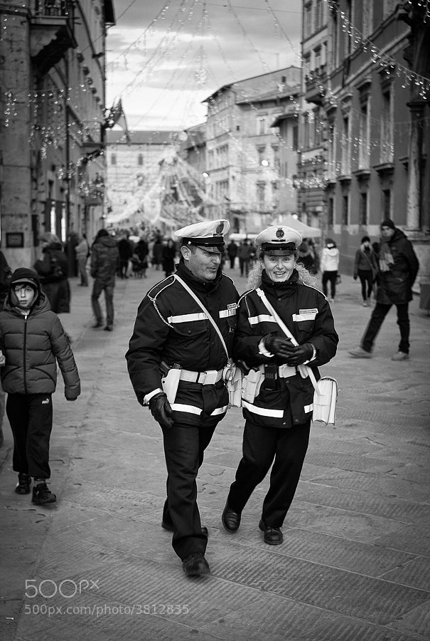 Two Italian police officers happy in their work on city street