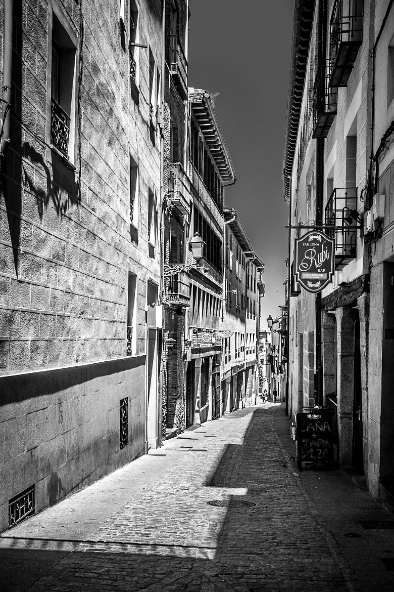 Photograph Walking down the street by Santiago Ojeda on 500px