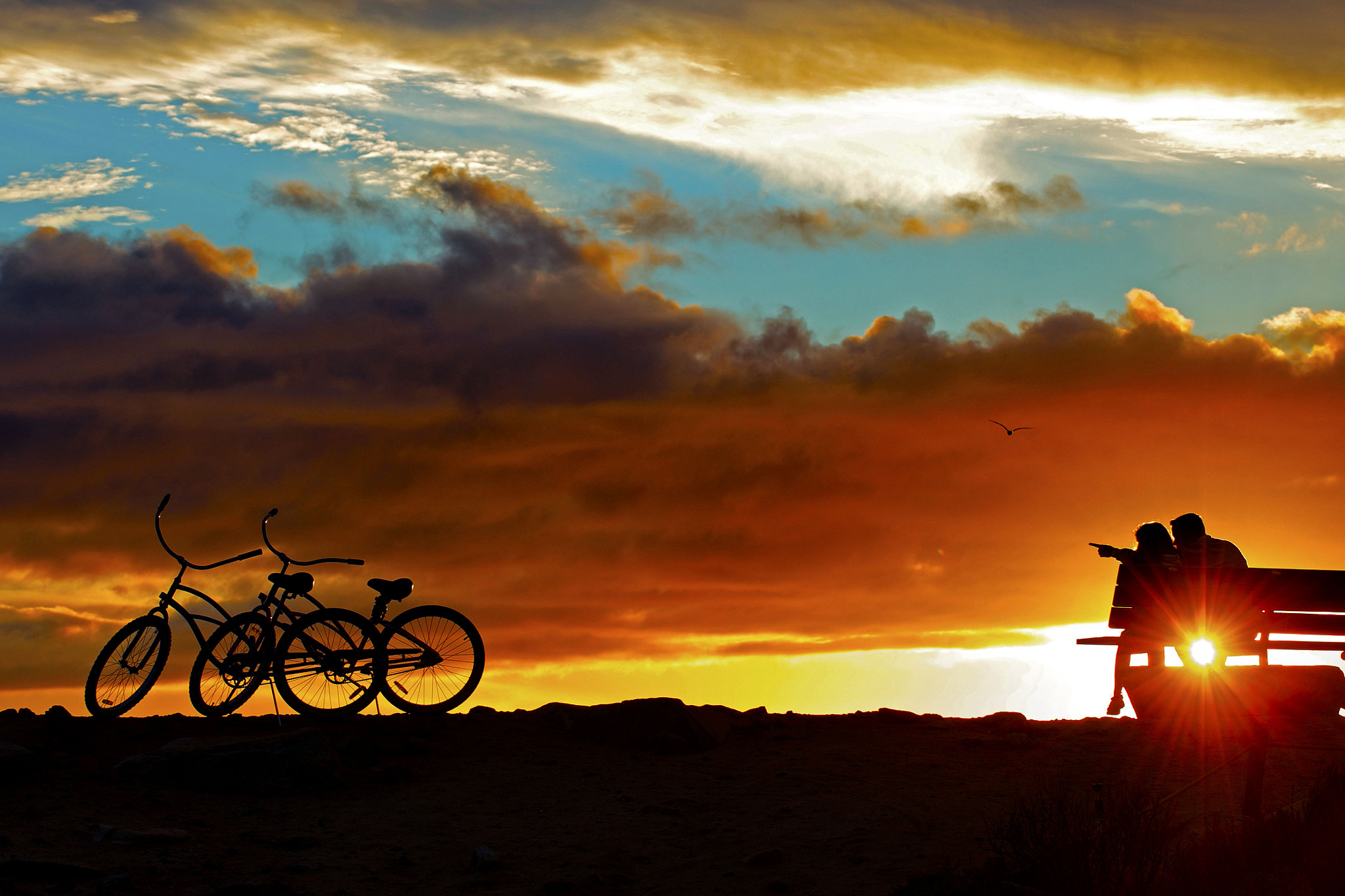 Photograph A Couple with Two Bikes at Sunset in Dana Point. by Rich Cruse on 500px