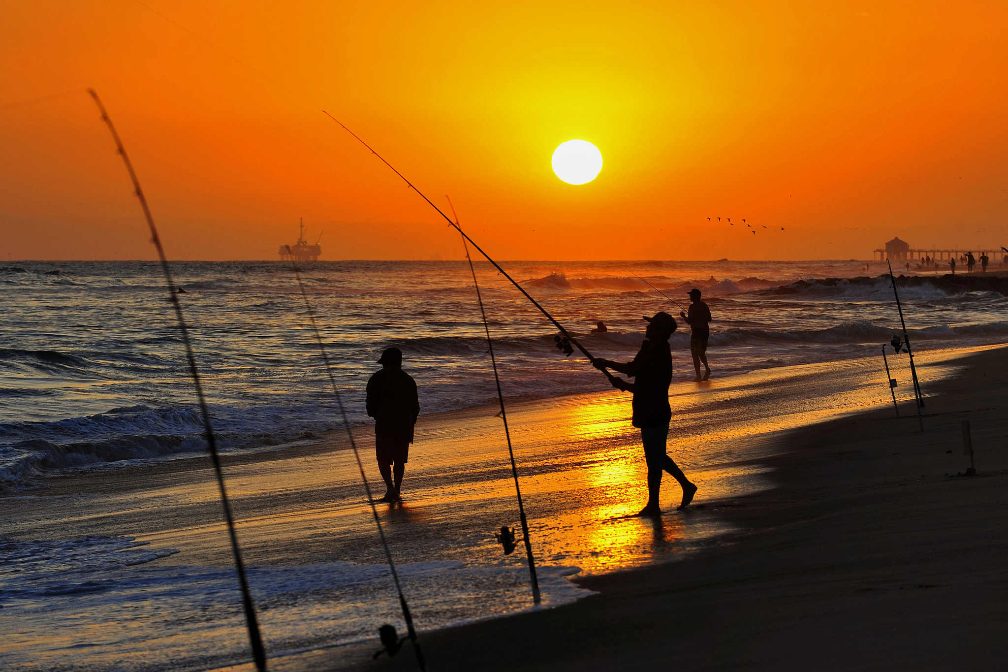 Photograph Surf Fishing at Sunset in Newport Beach - June 22, 2013 by Rich Cruse on 500px