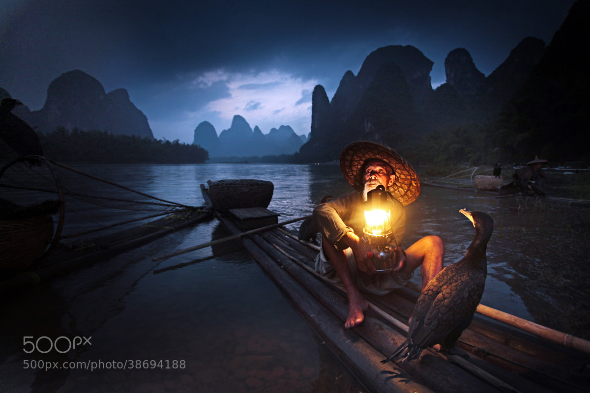 Photograph Old Fisherman and Cormorants, Guilin by Woosra Kim on 500px