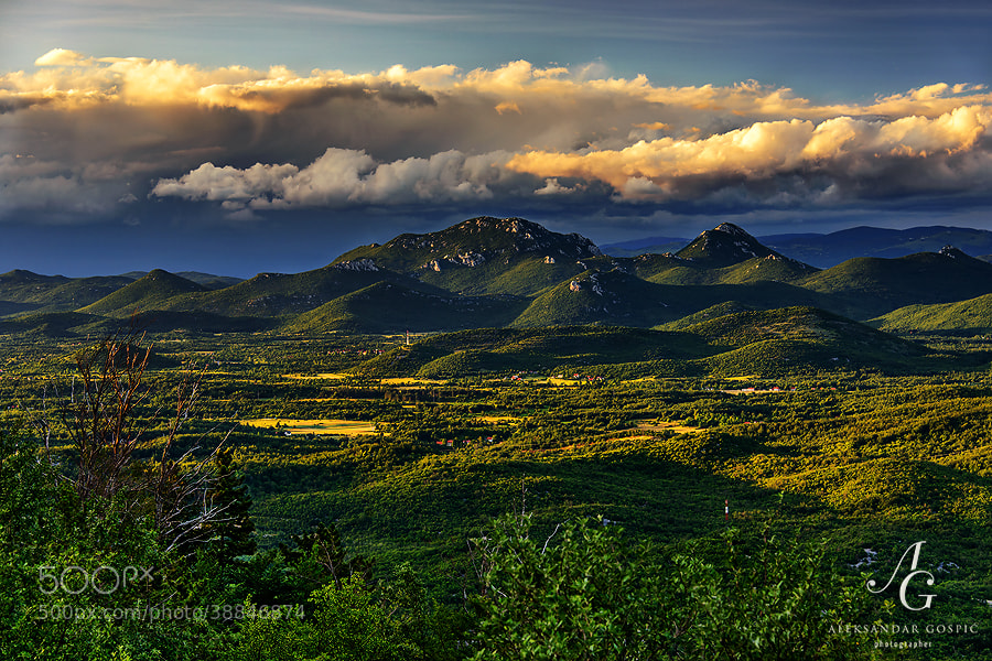 The end of the fresh summer day above Lika, mountainous and least inhabited region in Croatia, viewed from the slopes of Velebit mountain