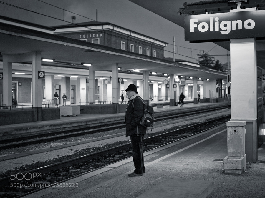 Man waits to catch his early morning train