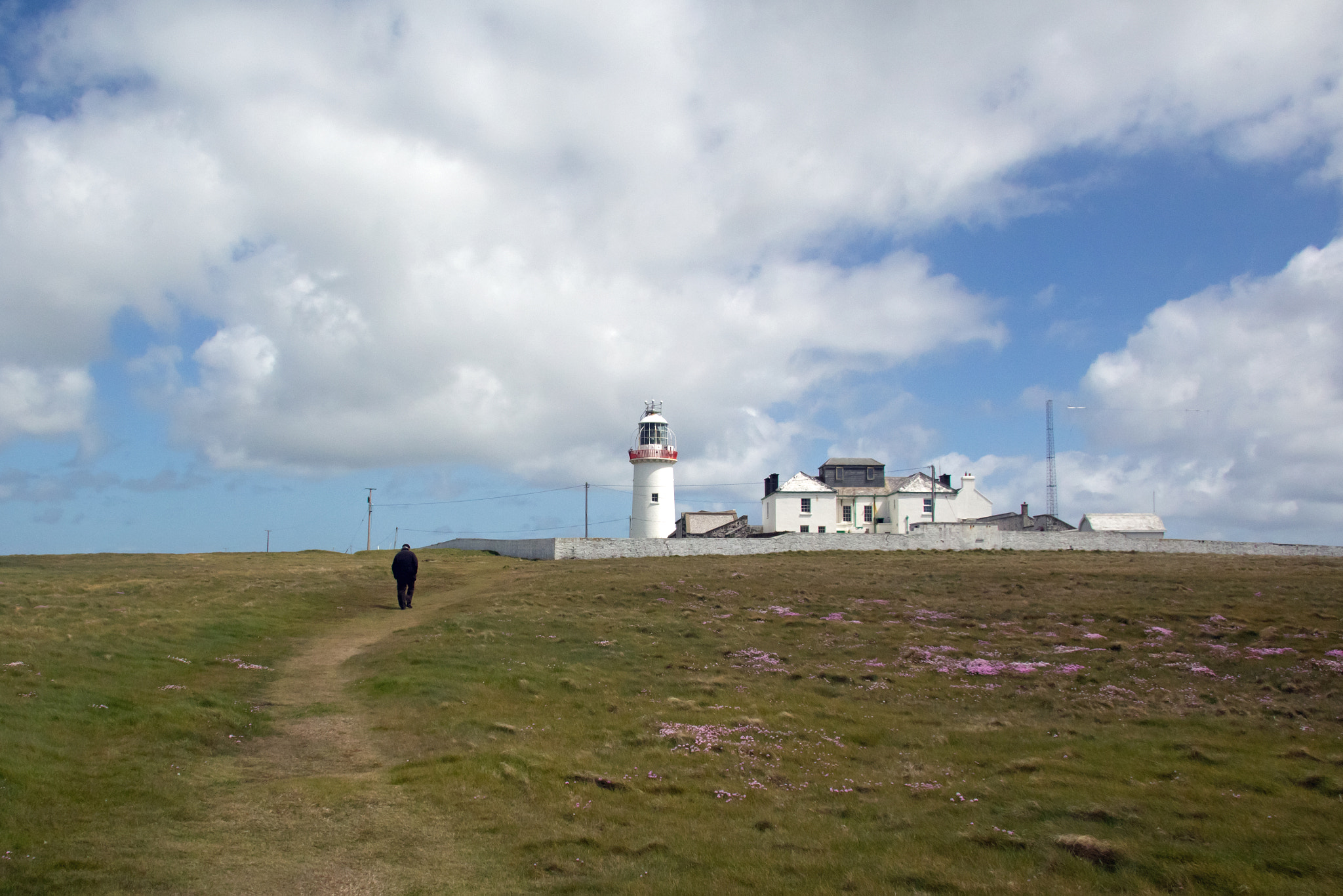 Photograph Solitary Irishman Walking at Loop Head Lighthouse by Maria Brown on 500px