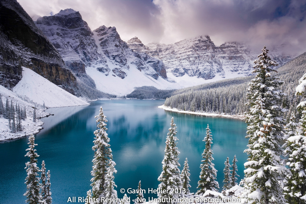 Photograph Wenkchemna Peaks or Ten Peaks rising over Moraine lake in the snow, near Lake Louise by Gavin Hellier on 500px