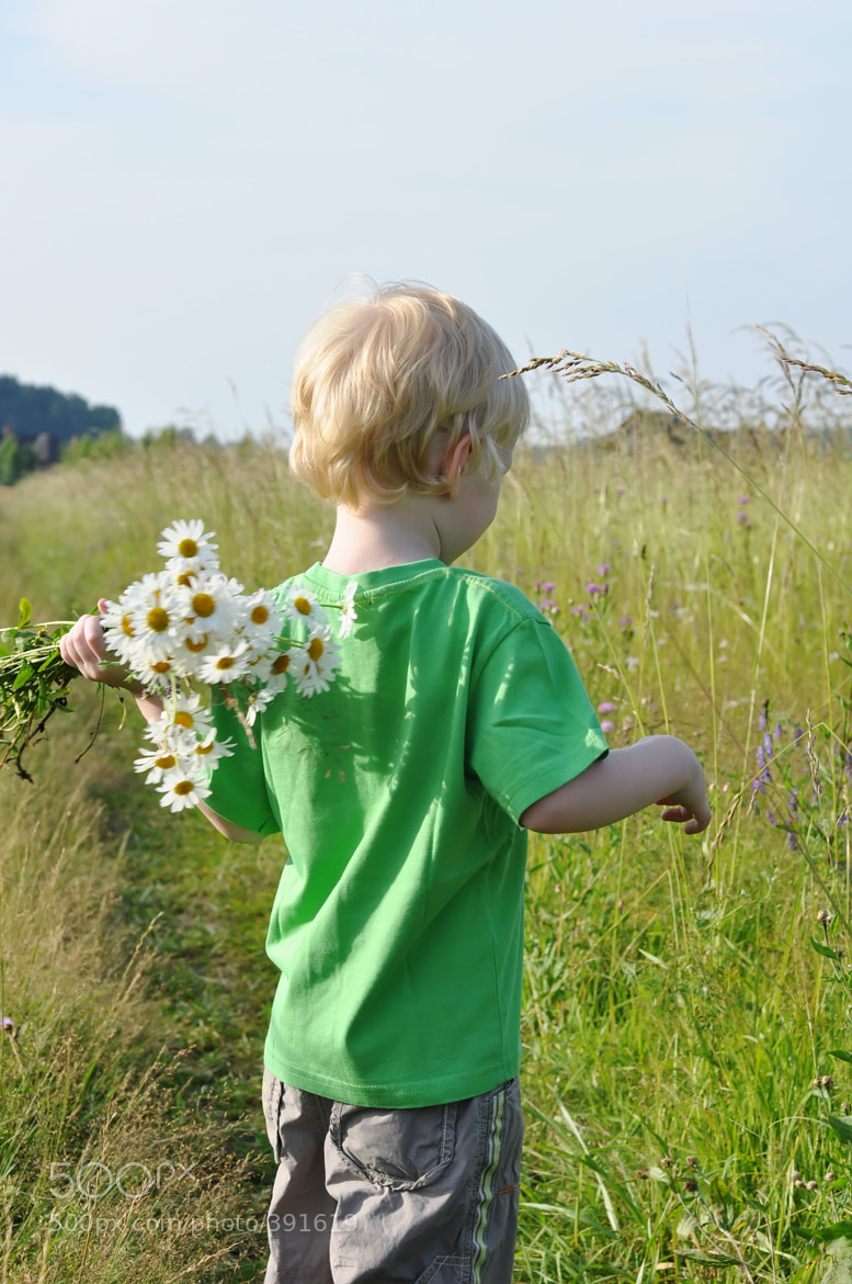 Photograph boy with daisies by Yulia Kuznetsova on 500px