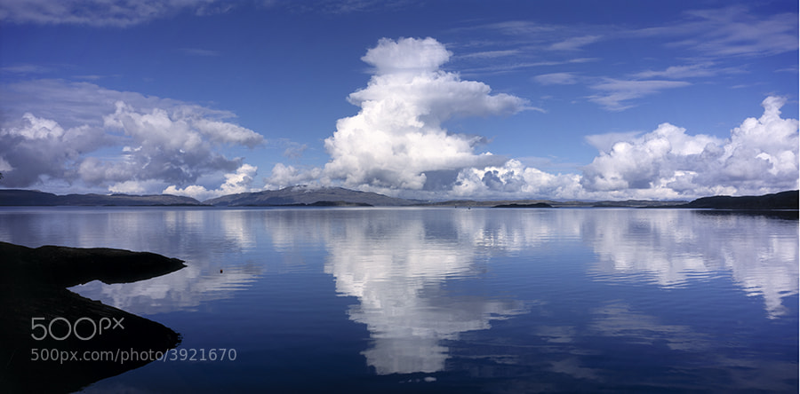 Clouds reflected in sea on Loch Crinan Scotland UK