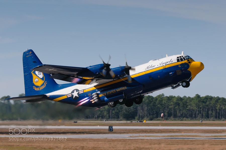 "The Blue Angels C-130 ""Fat Albert"" takes off using JATO for the very last time at the 2009 NAS Pensacola Homecoming Airshow. The first JATO bottles have started to fire and the others will start firing in a moment."