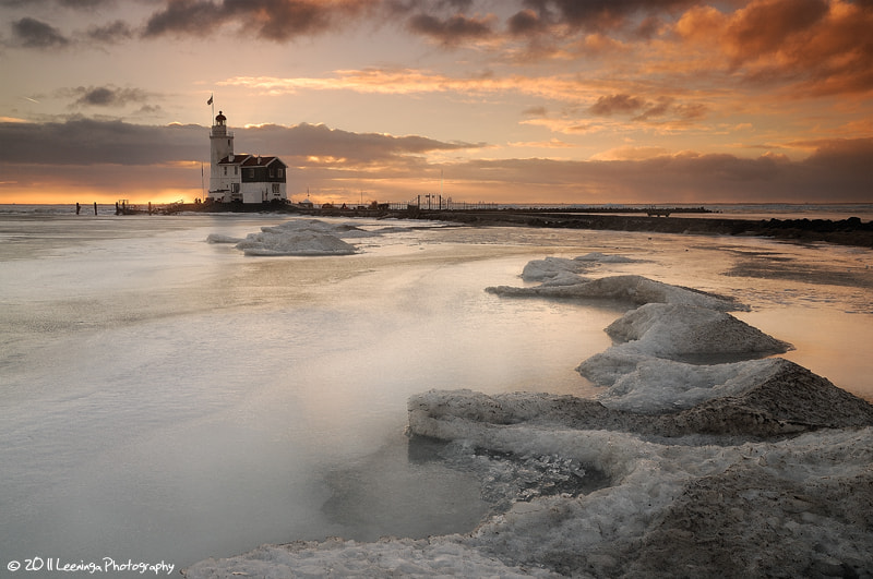 Photograph The lighthouse of Marken at sunrise during winter by Niels Leeninga on 500px