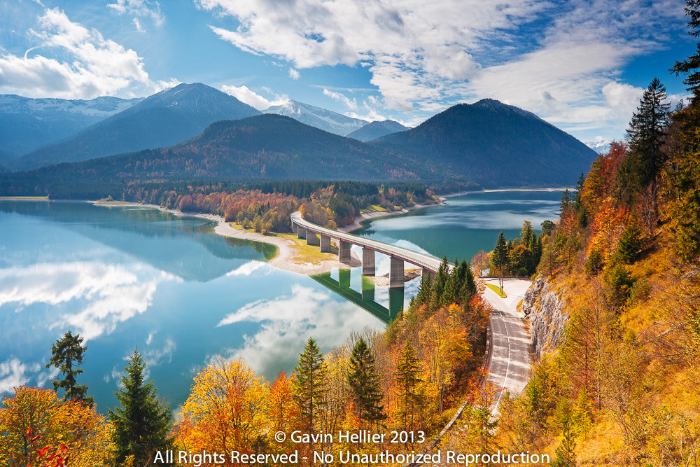 Photograph Autumn over Lake Sylvenstein, with mountains in the background, Bavaria, Germany by Gavin Hellier on 500px