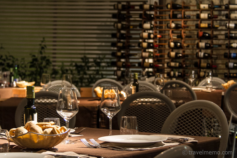 Photograph Restaurant table and wine rack by Walter Schaerer on 500px