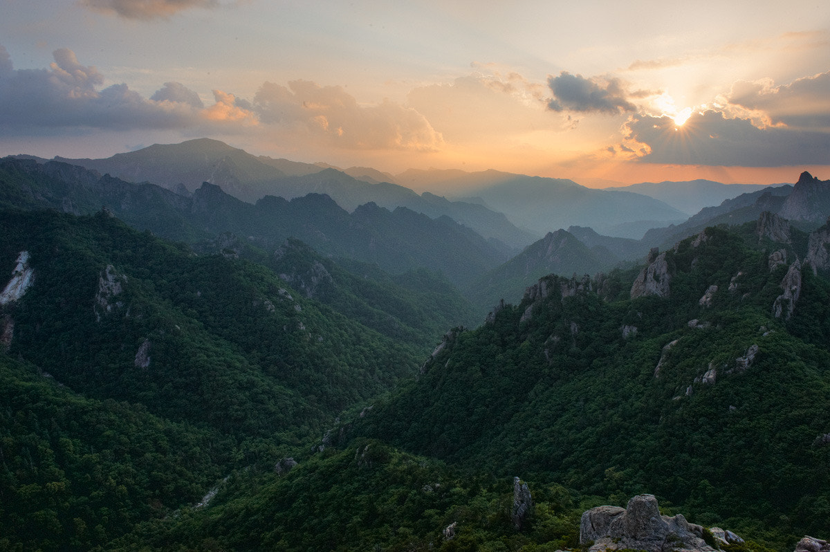 Photograph Sunset over Valley by Young-Beom Kim on 500px
