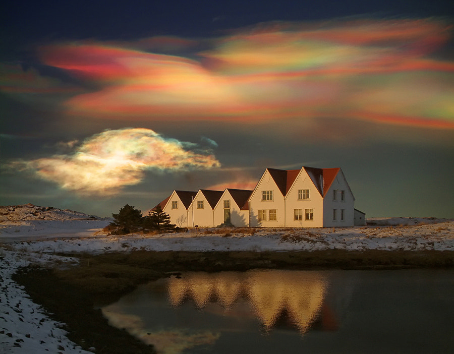 These kind of clouds (called Mother of Pearls, or nacreous clouds) are very rare, but mostly to be seen on the northen part of the earth, in the middle of winter. These clouds are very colorful and beautiful. I have only seen these clouds two times in my life.  (the quality of this photo is not so good, it was taken with an old Fujifilm camera)