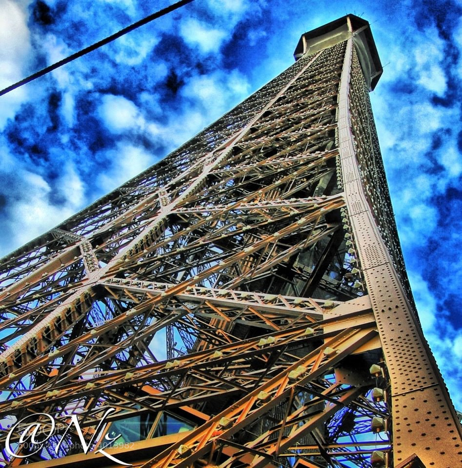 Photograph Up the Eiffel Tower by Nebula Noize on 500px