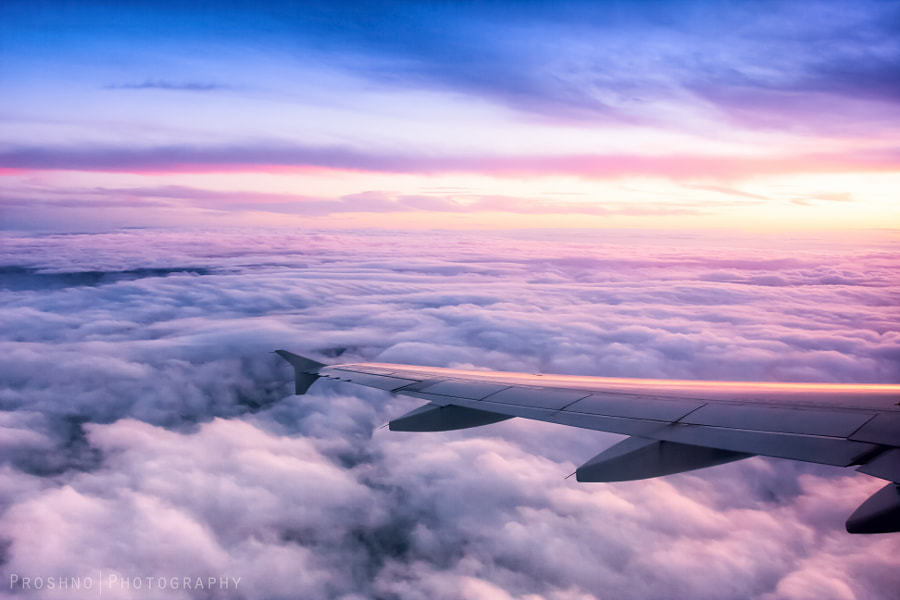 Sunset above the shroud of clouds