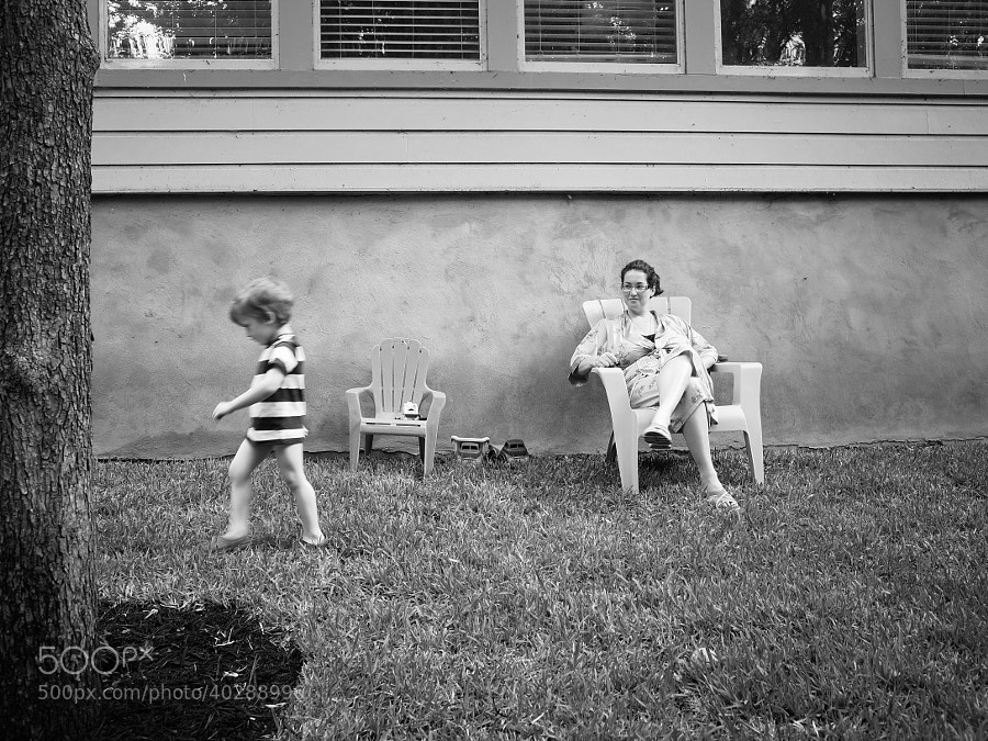 Jackson and Kristin in the backyard (Jackson stomping away) by C.K. Sample III (cksample)) on 500px.com