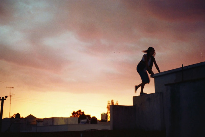 Photograph GIRL, SUNSET & ROOFTOP by Joel Sossa on 500px