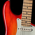 This is my latest guitar: a Fender American Deluxe Stratocaster in ash, with a maple neck and fretboard.  The finish is called Aged Cherry Sunburst.