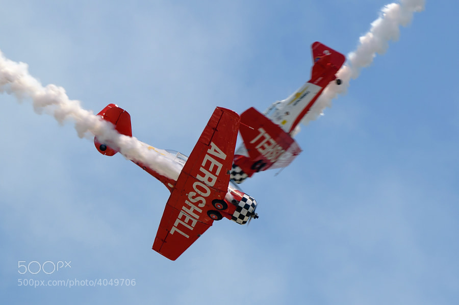 2 Team Aeroshell T-6 Texans cross at show center during the Vidalia Airshow