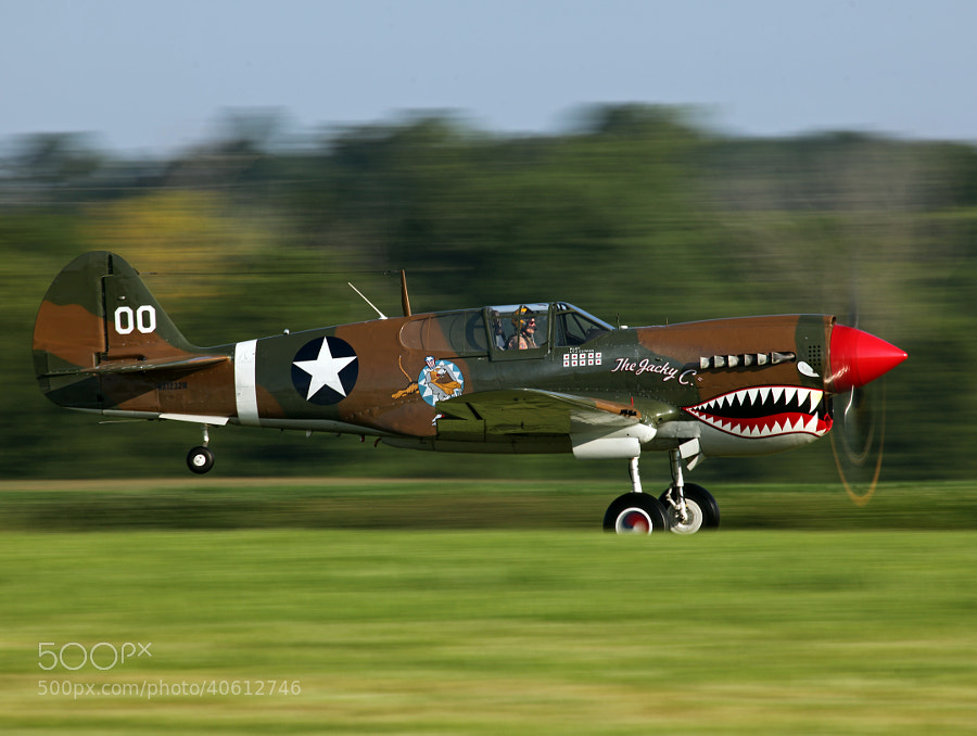 Curtiss P-40 Warhawk taking off at the Geneseo Air Show, AKA, The Greatest Show On Turf!