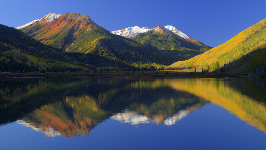 Early morning reflection with aspens changing their color