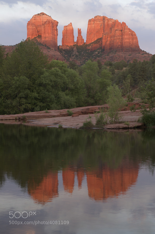 Setting sun on Cathedral Rock withe reflection into Oak Creek