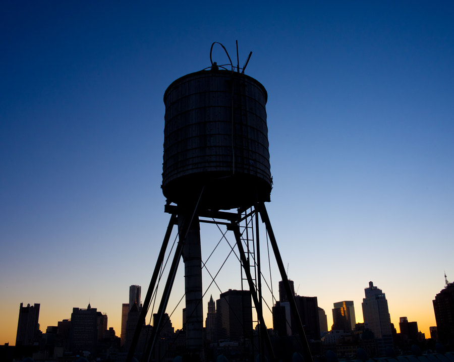 Water tank at sunset in Manhattan, NYC