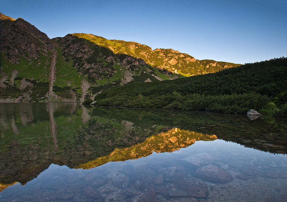 Photograph Sunrise over the Black Pond in the Tatras by Jakub Malicki on 500px