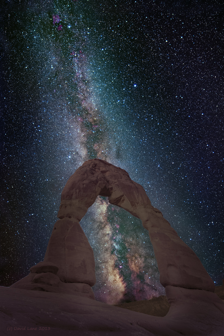 Photograph Galactic Peekaboo at Delicate Arch by David Lane on 500px