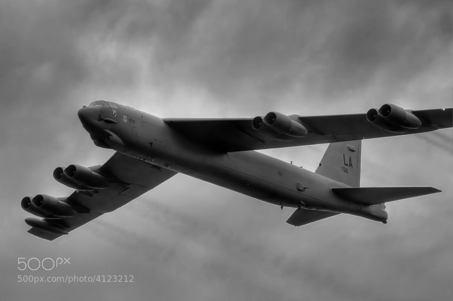 "A B-52 Stratofortress or ""BUFF"" makes a high speed pass under a heavy cloud deck. Vidalia, Georgia"