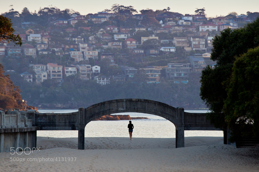 Early morning image of a jogger passing under this bridge on Balmoral Beach