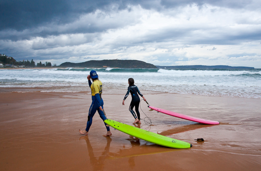 Two surfers brave the cold water on this beach near Sydney