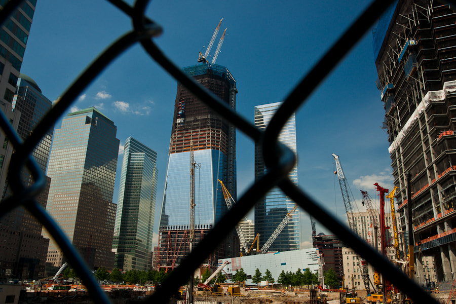 Cranes on the Freedom Tower are seen as part of the rebuilding of the World Trade Center site.  The world sees America's freedom, independence, and resilience