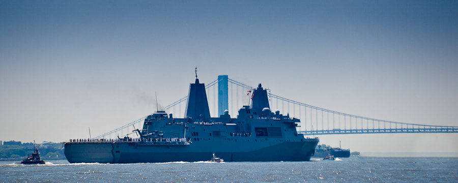 This ship, partially built out of metal from the fallen World Trade Center, is sailing toward the Verrazano-Narrows bridge in New York Harbor during the beginning of Fleet Week.