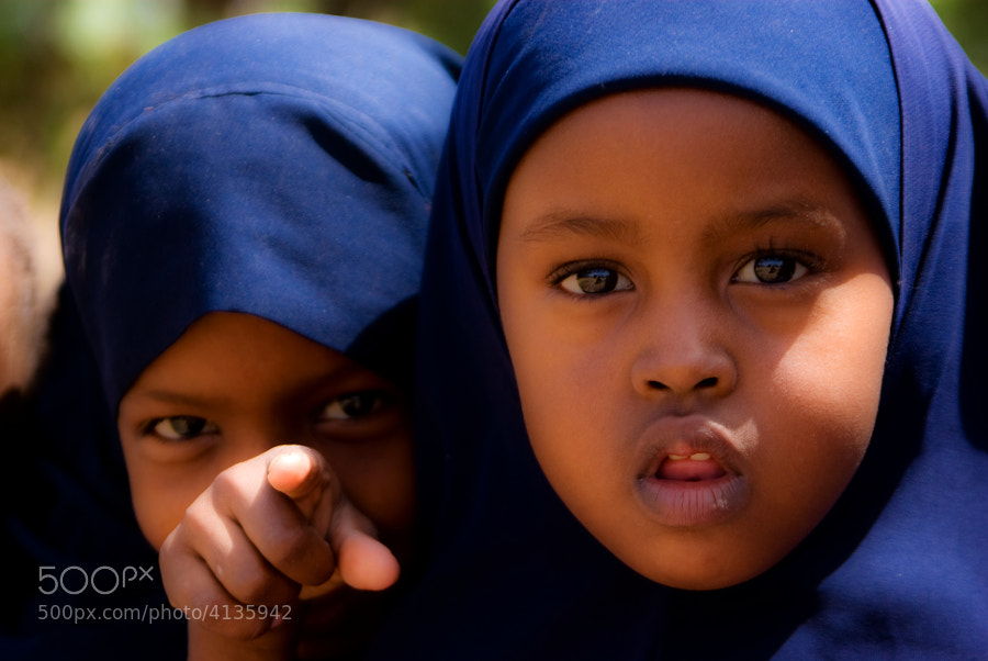 These wonderful little girls were very curious about the strange pink man with the large black camera around his neck. Garissa, Kenya.