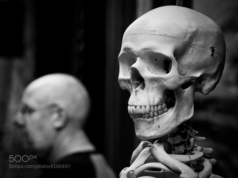 A bald man happened to walk past this skeleton