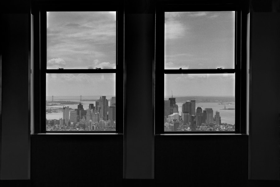 Lower Manhattan is seen through a window of the Empire State Building