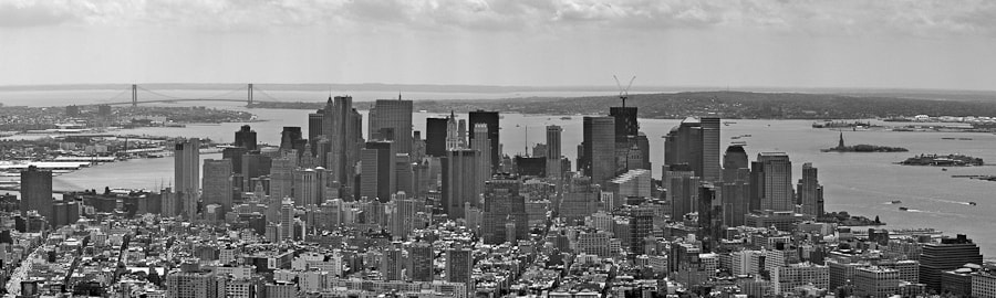 This image is a result of 9 images taken from the Empire State Building then combined in Photoshop.  It is better viewed by clicking on the image and looking at the 2000 pixel image.  The building with the cranes is the new Freedom Tower being built on the World Trade Center Site.
