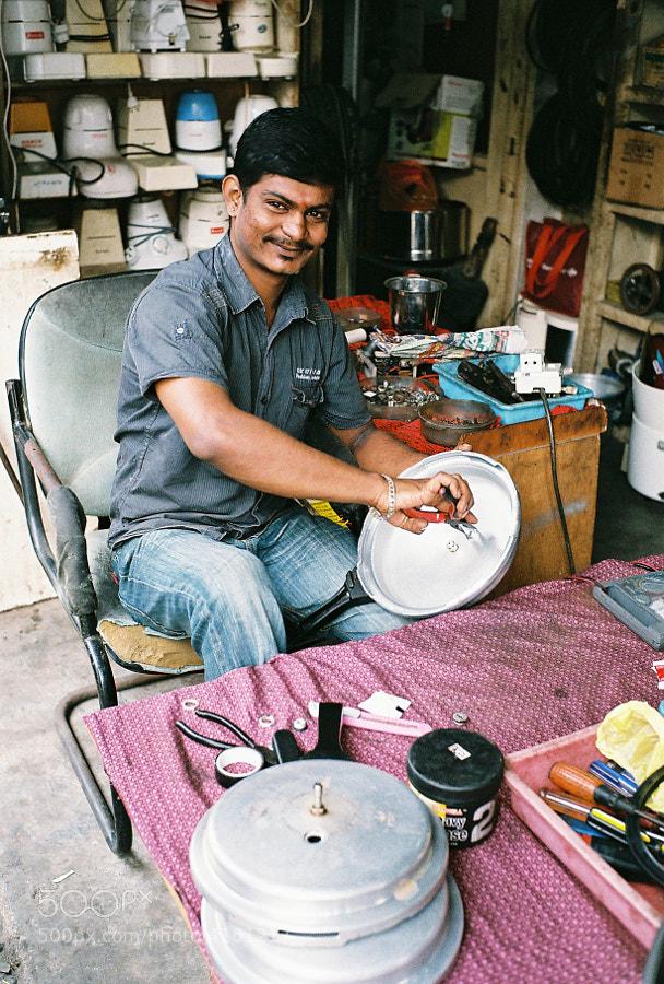 Repair man at Klang, Selangor, Malaysia.