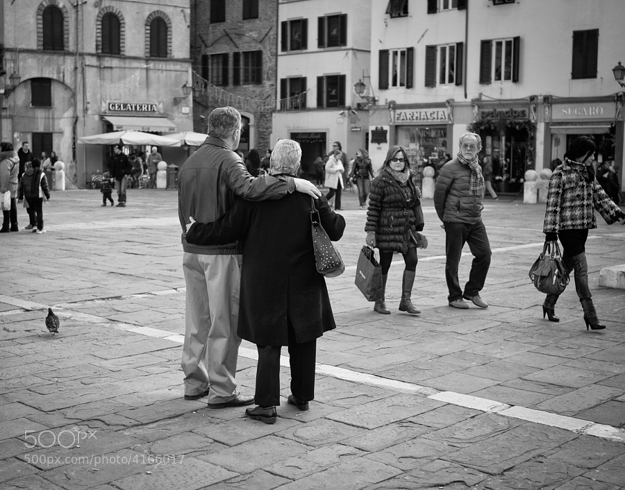 Older couple display real tenderness on an Italian Piazza