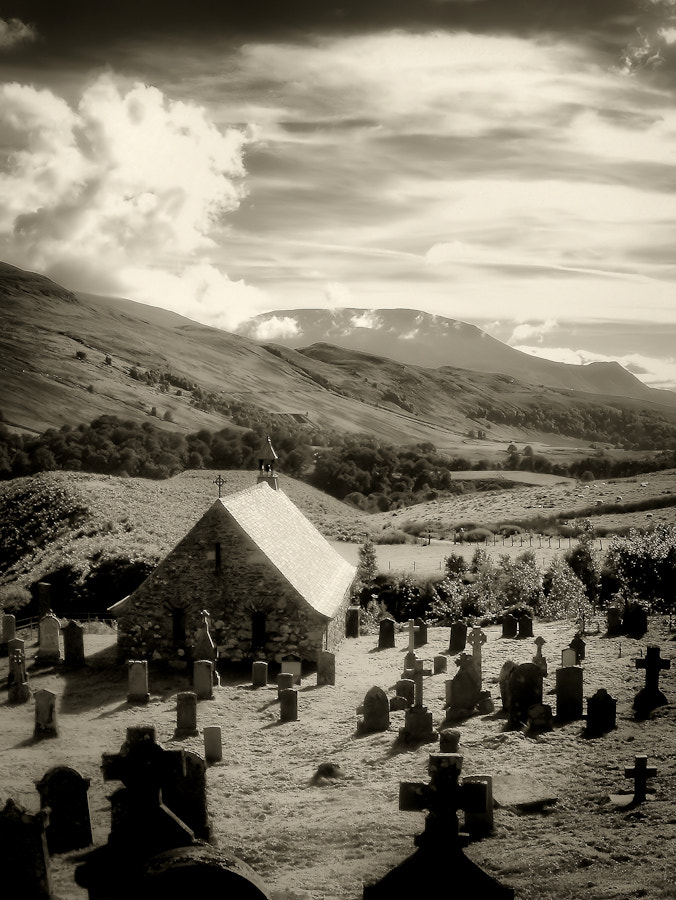 Cille Choirill, a simple ancient church building and graveyard on a 4th Century sacred site, with Aonach Mor in the background