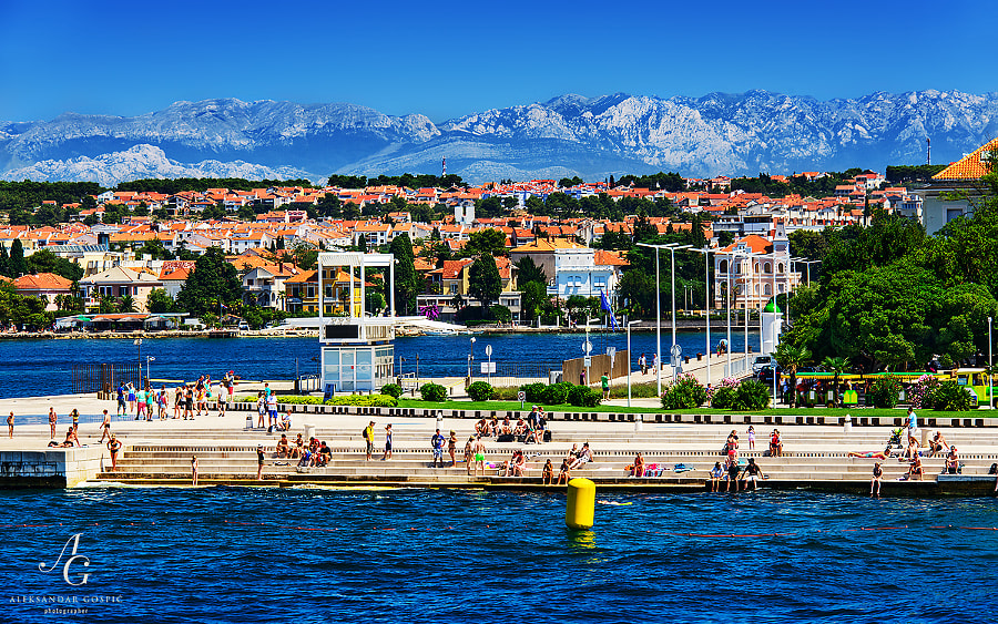 Summer on Zadar's Sea Organ, in the distance is Velebit range