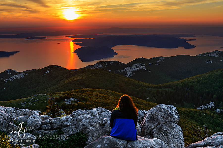 From Velebit mountain Sanja enjoys the end of the day as sun goes down behind the islands of Kvarner bay and Istria peninsula