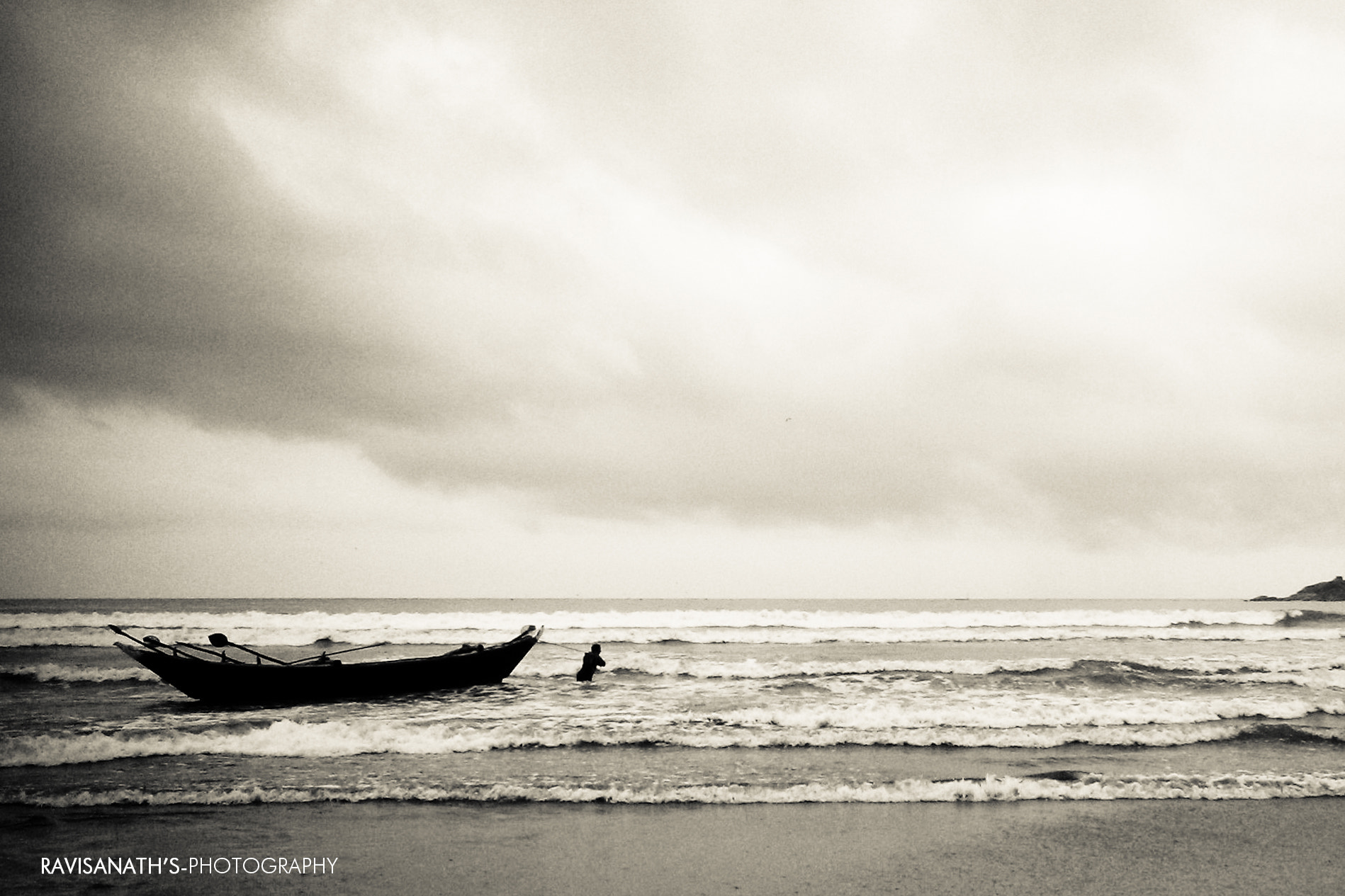 Photograph Silhouette of Boat at Beach by Ravisanath  on 500px